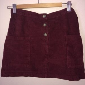 This is a Zara maroon, velvet mini skirt!